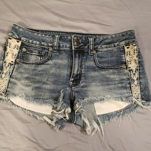 American Eagle denim shorts with lace detail